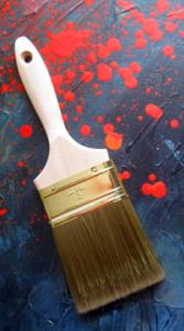 paintbrush-on-spattered-background-1439539-m