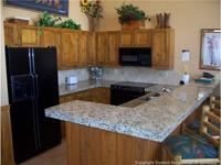 kitchen view of breckenridge condo for sale at one breckenridge place
